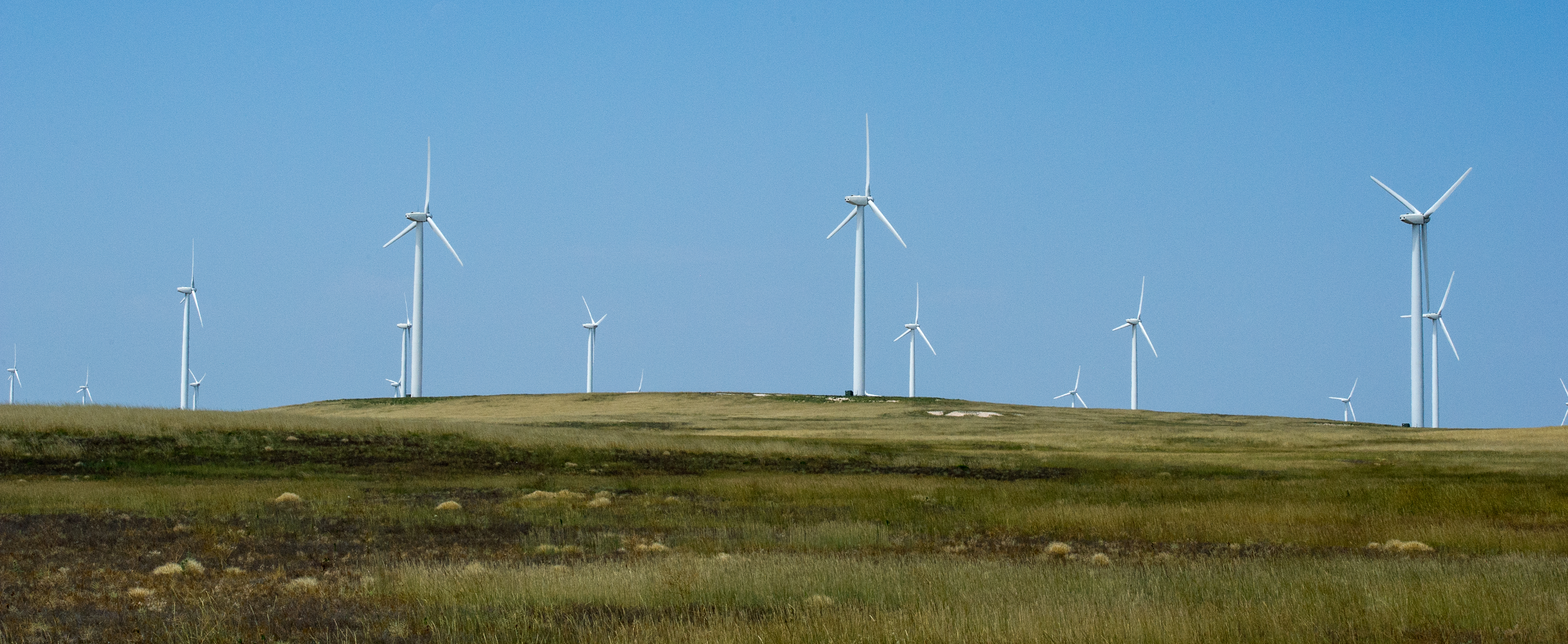 July 18, 2014 - Utility scale wind turbines at the Cedar Creek Wind Farm in Grover, Colorado. (Photo by Dennis Schroeder / NREL