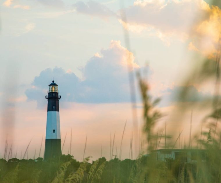 A lighthouse at sunset on Tybee Island, Georgia. The island is located in Chatham County, where the Smart Sea Level Sensors program is being implemented. Credit: Impact Media Lab / AAAS