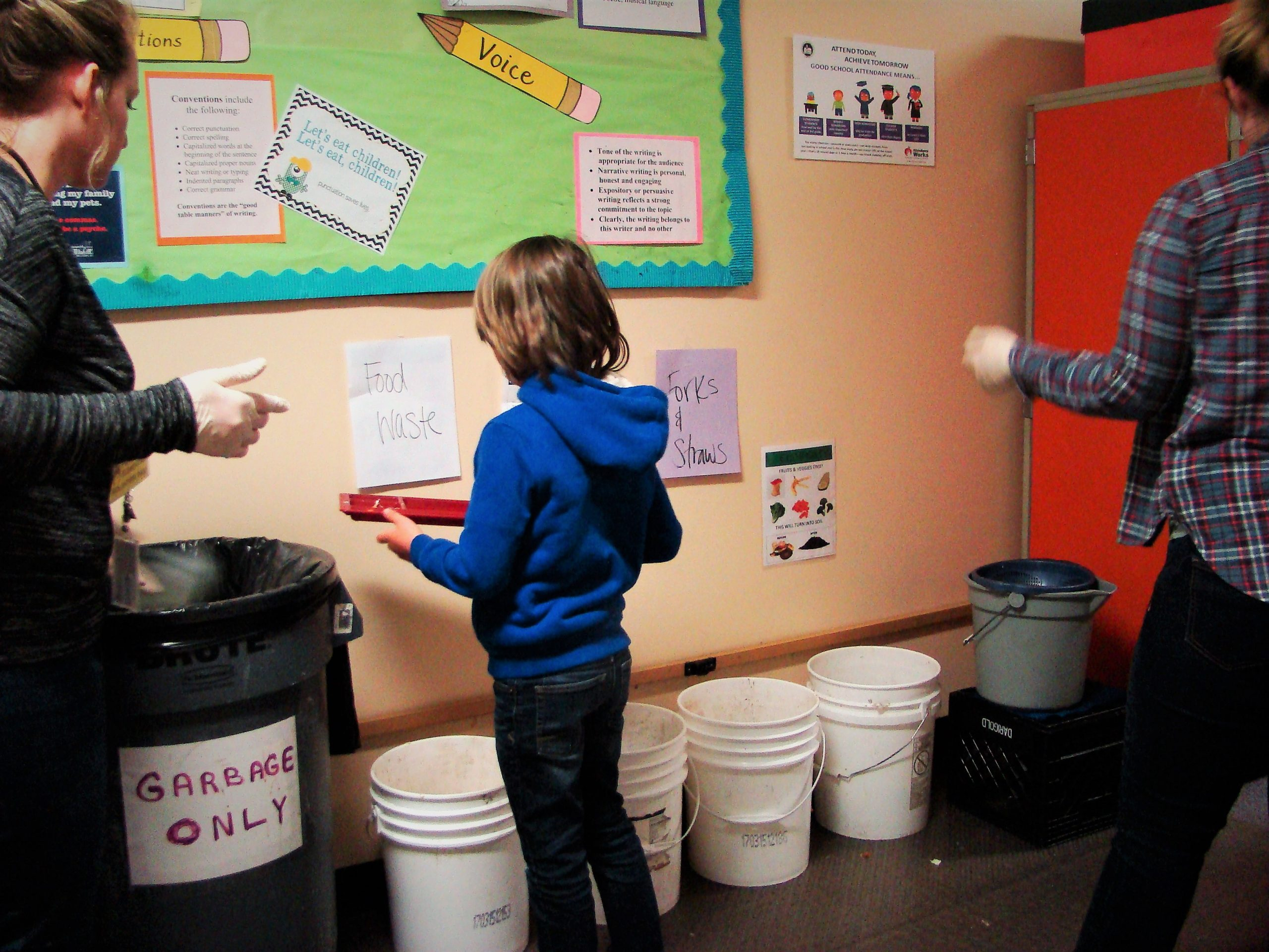 Student carrying a bucket of food waste from school lunches at the Franklin Elementary Food Waste event