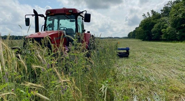 Picture of tractor. Mac Kincaid has seen vast improvements on his farm since he started using cover crops